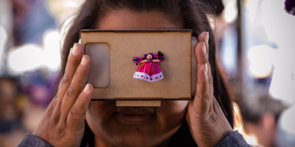 Young girl using Google Cardboard.